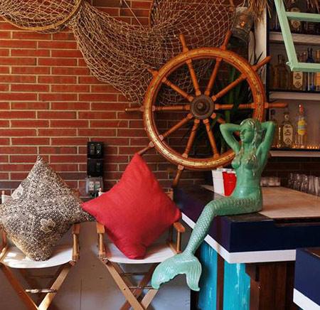 Mermaid , ships wheel and netting