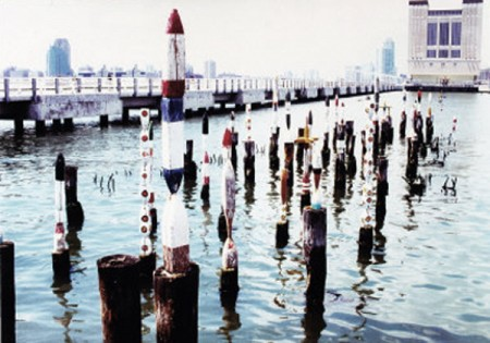 This is an artists installation of our old net buoys on old wharf pilings in the Hudson River NYC. As the tide rose and fell, it would reveal an ever changing landscape painting!